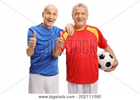 Two elderly soccer players making thumb up signs isolated on white background