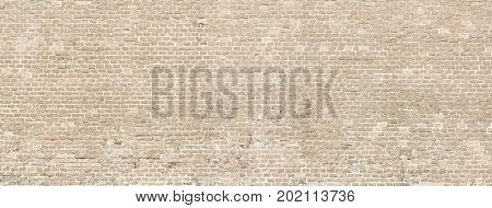 Vintage whitewashed brick wall panoramic background texture. Home and office wall design backdrop
