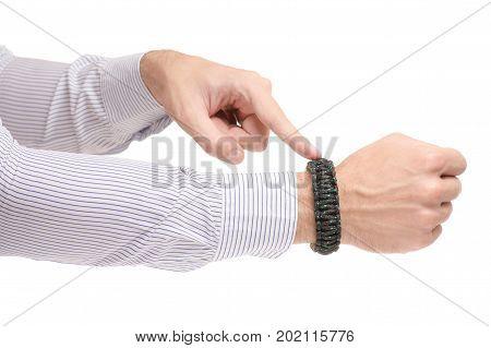 Paracord bracelet on hand on white background isolation