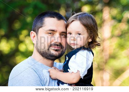 happy family and father's day. child daughter kissing and hugging dad.