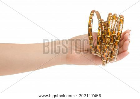 Female hand holding a light-emitting diode tape on a white background isolation