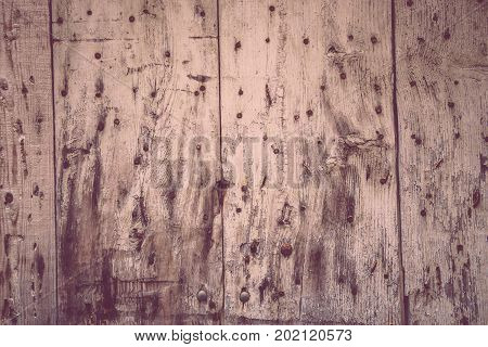Old wood background texture. Vintage door or shutters and metal elements. Rural architecture. With South french provence cote d'azur look and feel.