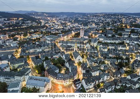 Aerial view over the old town of Siegen illuminated at night. North Rhine-Westphalia Germany