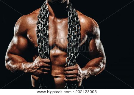 Strong Athletic Bodybuilder With Metalic Chain,six Pack, Perfect Abs, Shoulders, Biceps, And Triceps