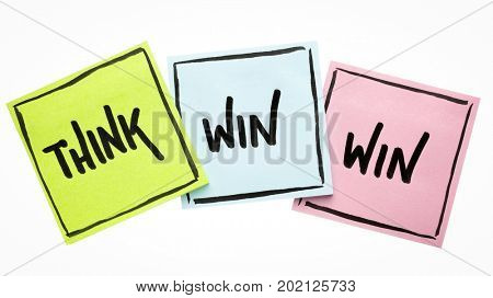 Think win-win concept  - handwriting on sticky notes isolated on white