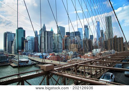 View of the city from Brooklyn bridge in New York is one of the oldest bridges of either type in the United States. Completed in 1883.