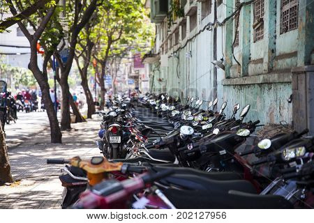 Ho Chi Minh City, Vietnam - March 26, 2017: Parked motorcycles in Binh Tay Market, the Central Market of Cholon. Cholon is the Chinatown area of Saigon