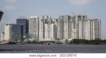 Ho Chi Minh City, Vietnam - March 26, 2017: New luxury apartments, residential buildings rise in Saigon, Vietnam. Saigon is the highest population-concentrated city in the country.