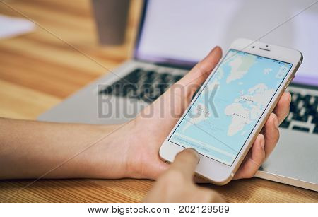 Bangkok Thailand - August 31, 2017 : Women hold a phone with show screen Google Maps is web mapping service application and technology provided by Google.