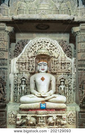Vertical picture of Jain God statue inside the Jain Temples located in the Golden City of Jaisalmer in India.