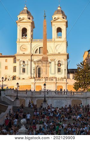 ROME,ITALY - JULY 17,2017 : The famous Spanish Steps and the Trinita dei Monti church at Piazza di Spagna in central Rome at sunset