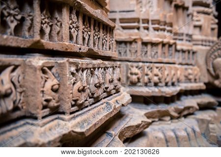 Horizontal picture of with focus on marble stone carving on the wall of Jain Temples inside the fort of Jaisalmer in India.