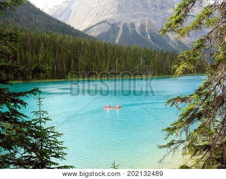 Boaters on the peaceful turquoise waters of Emerald Lake in Yoho National Park.