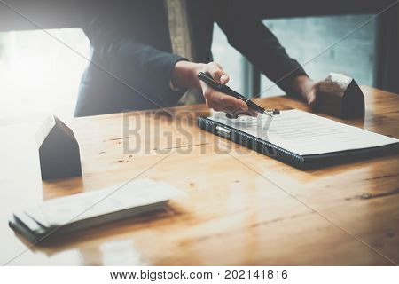 Real Estate Concept - Businessman Offer To Signs Contract With Home Architectural Model At His Offic