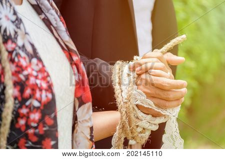 Bride and Groom Tied up together concept of Deep Connection more than Love.
