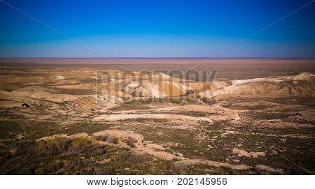 Panorama view to Aral sea from the rim of Plateau Ustyurt at sunset in Karakalpakstan Uzbekistan