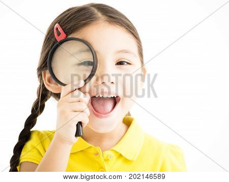 happy little girl with magnifying glass isolated