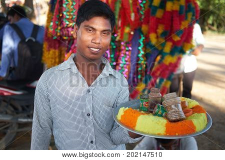Dhaka, bangladesh, august 2017-a man selling food items for upcomming biggest muslim eid ul adha festival located at aftab nagar cow market in dhaka in bangladesh taken on 30, august 2017