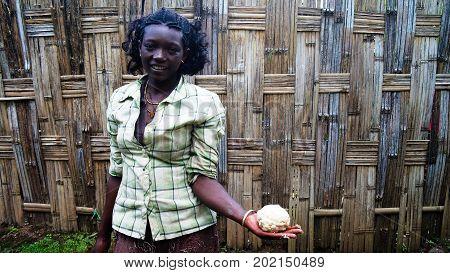 Dorze tribe girls with dough - 02 october 2012 Chencha Ethiopia