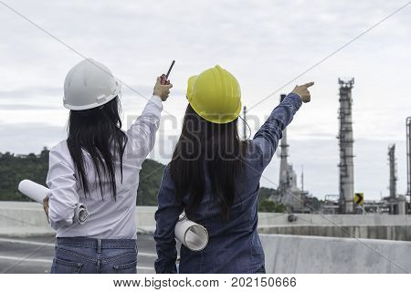 Engineers woman holding radio blueprint and report schedule for workers security control at power plant energy industry Engineer Conceptprofessionalsafetyindustry