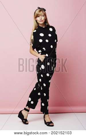 Fashion Beautiful woman in spotted jumpsuit posing
