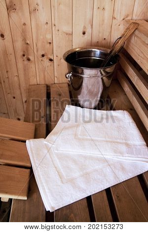 wooden sauna room, shooting objects of sauna equipment with bath towel in the the empty steam room