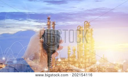 Communication with Radio for work concept Worker contact use radio on petrochemical plant background Operator work