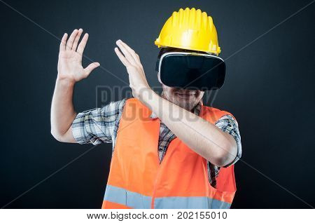 Constructor Wearing Vr Goggles Gesturing With Hands