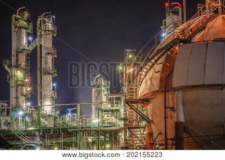 Oil refinery plant with night Gas storage tank in petrochemical plant at night time