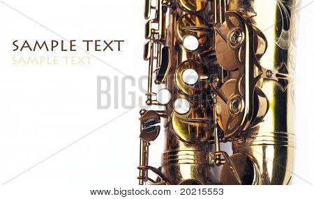 close-up of a beautiful golden saxophone against white background
