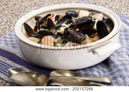 traditional irish fish soup with mussels in a terrine