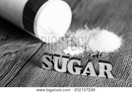 Sweetener Tablet And Sugar. Text Sugar Wooden Letters.