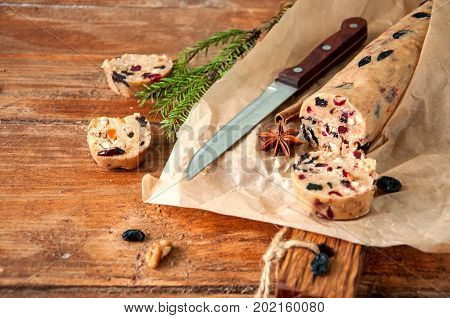 Christmas Cake Cookies Batter on wooden board. Fruit cake cookies dough. Cookies in process. Copy space.