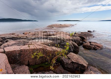 Rocky granite rock shore summer landscape scenery of Lake Superior Ontario ON Canada