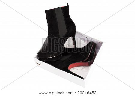 Black Suede Boots With Red Soles On The Platform And High Heels