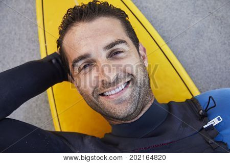 Portrait of surf dude on board smiling