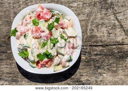 Fresh Salad With Tomato, Cucumber, Onion, Parsley And Mayonnaise On Rustic Wooden Table