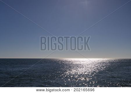 Horizon view over Atlantic Ocean from Jard sur Mer in Vendee France with reflection of sun light over the water