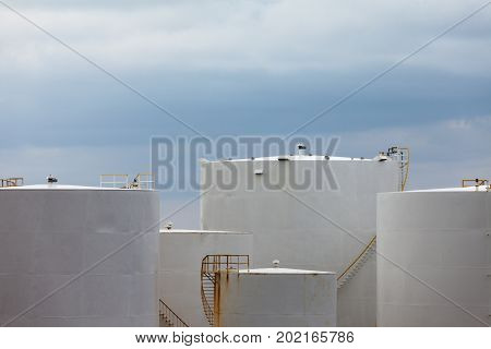 Steel storage tanks at refinery terminal used for storage and distribution of petrochemical products