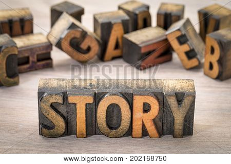 story word  abstract - text in vintage letterpress wood type blocks