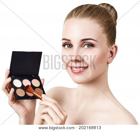 Young woman with contouring make-up holding palette for contouring face. Isolated on white background.