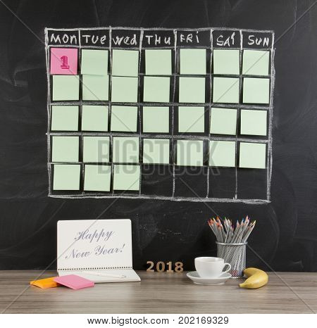 New Year's concept: grid timetable schedule with decoration on black chalkboard background