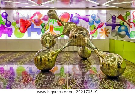 NAPLES, ITALY - AUGUST 11, 2016: University metro station interior. Synapsi, a sculpture in brushed steel which refers to human intelligence and the neural network of the brain designed by Rashid.