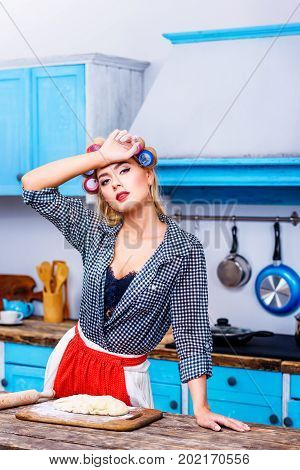 Tired Housewife In Kitchen