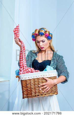 Housewife Holding Laundry In Basket
