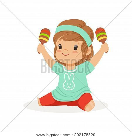 Sweet little girl sitting on the floor and playing maracas, young musician with toy musical instrument, musical education for kids cartoon vector Illustration on a white background