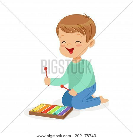 Cute little boy playing xylophone, young musician with toy musical instrument, musical education for kids cartoon vector Illustration on a white background