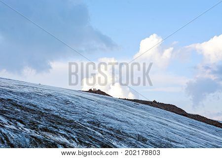Snow covered Elbrus mountains at winter sunny day.