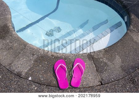 Flip flops at private pool side, British Columbia, Canada