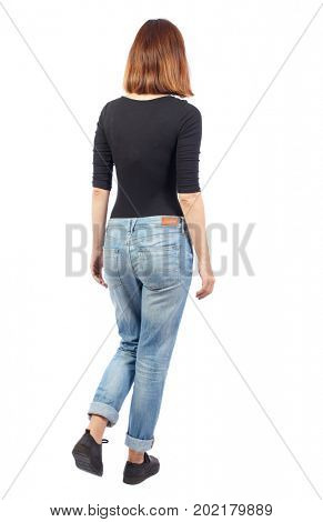 back view of walking  woman. beautiful blonde girl in motion.  backside view of person.  Rear view people collection. Isolated over white background.  A girl in a black jacket goes into the distance